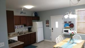 Open kitchen and dining area with a dining large enough for family games (games provided)